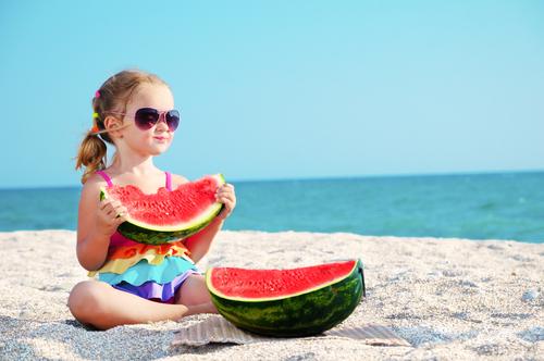 child eating healthy beach snacks watermelon